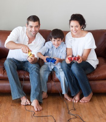 10115506-radiant-family-playing-video-games-in-the-living-room