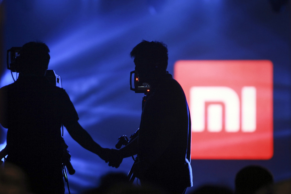 A logo of Xiaomi is seen at Xiaomi's tablet launch event in Beijing