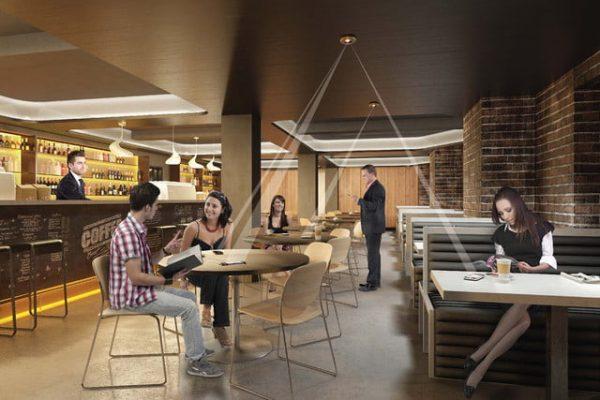 grafika przedstawiająca ładowanie telefonów bezprzewodowo w kawiarni