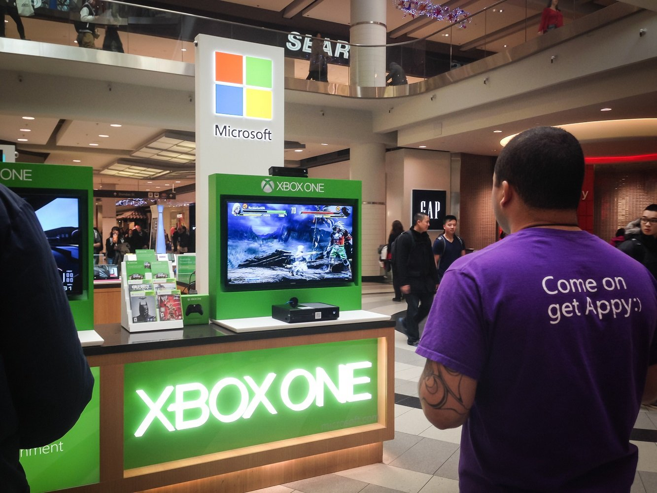 TORONTO - NOVEMBER 15: Microsoft staff demonstrates the Xbox One at the mall in Toronto, Canada on November 15, 2013.