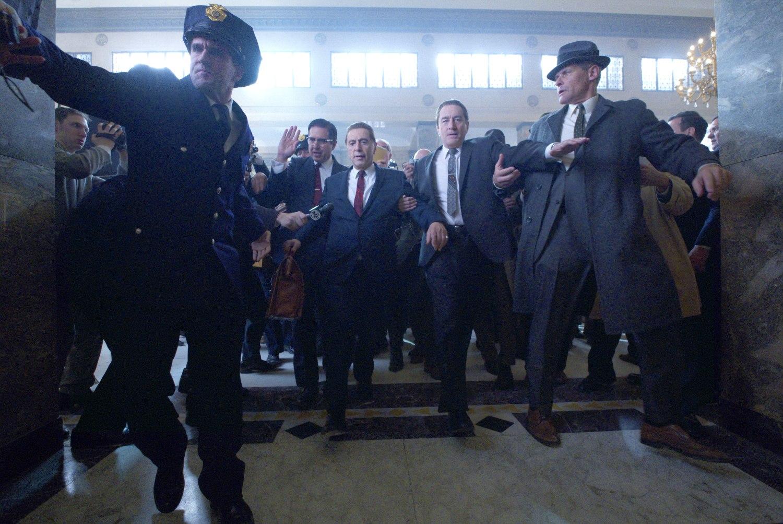 Teamster lawyer Bill Bufalino (Ray Romano) and Frank Sheeran (Robert De Niro) escort Jimmy Hoffa (Al Pacino) to court. Photo Credit: Niko Tavernise. © 2019 Netlfix US, LLC. All rights reserved.